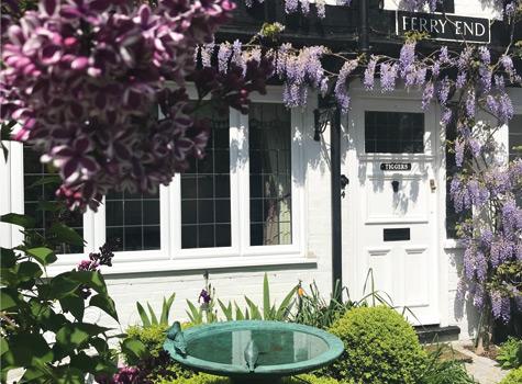 Tiggers-cottage-front-door-birdfeeder